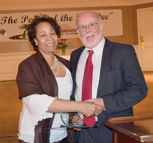 Photo Caption: Legacy of the Year 2016 Dr. Wilson, accepted by son Dr. Tommy Wilson, with Chamber Chairperson Jannie Lathan (Taken by Jana Pye, editor, News & Press)